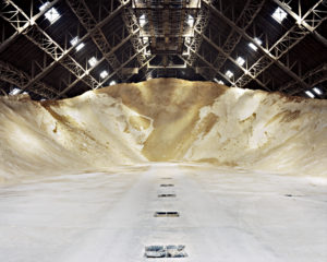 Warehouse partially empty but mounds of sugar still high at far end